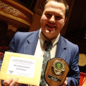 Matthew Bradley Flugel player for Knottingley receives his' Best Soloist' shield at the Yorkshire Regional Championships 2010, St Georges Hall Bradfor