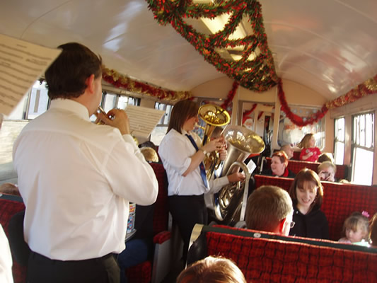 band playing carols on a train